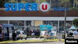 A general view shows gendarmes and police officers at a supermarket after a hostage situation in Trebes, France, March 23, 2018.