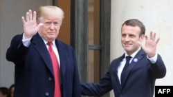 U.S. President Donald Trump is welcomed by French President Emmanuel Macron as he arrives for bilateral talks at the Elysee Palace in Paris, Nov. 10, 2018.