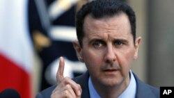 Tổng thống Syria Bashar al-Assad nói chuyện tại một cuộc họp báo
