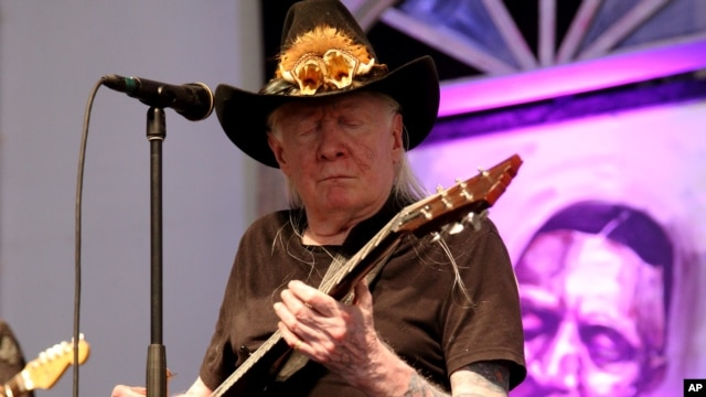 Johnny Winter performs at the 2014 New Orleans Jazz & Heritage Festival at Fair Grounds Race Course in New Orleans, May 3, 2014.