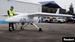 FILE - A technician checks a surveillance Unmanned Aerial Vehicles (UAV) drone operated by the United Nations in the Democratic Republic of Congo's eastern city of Goma. United Nations forces in Democratic Republic of Congo launched unmanned aircraft to monitor the volatile border with Rwanda and Uganda, the first time.