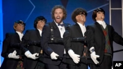 Host T.J. Miller, center, performs on stage at the 21st annual Critics' Choice Awards at the Barker Hangar in Santa Monica, Calif., Jan. 17, 2016.