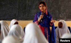 FILE - Pakistani Nobel Peace Prize laureate Malala Yousafzai addresses students at the Nasib Secondary School in Ifo2 area of Dadaab refugee camp during celebrations to mark her 19th birthday near the Kenya-Somalia border, July 12, 2016.