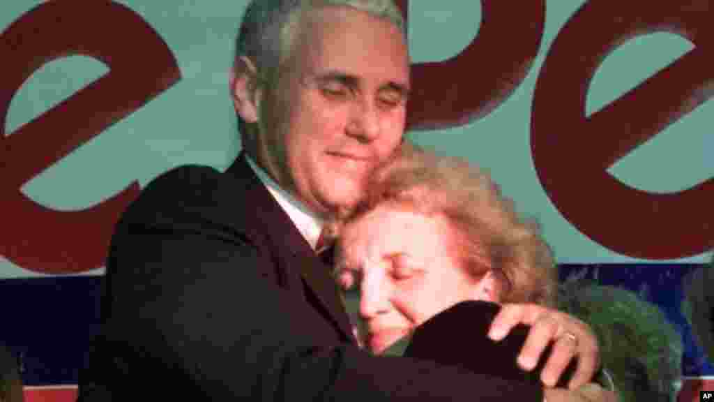 Republican candidate Mike Pence, left, hugs his mother Nancy Pence following his victory speech in Anderson, Indiana, Nov. 7, 2000. Pence defeated Democrat Bob Rock for the seat in Indiana's 2nd Congressional District.