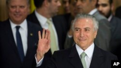 Brazil's acting President Michel Temer arrives to speak, at Planalto presidential palace in Brasilia, Brazil, Thursday, May 12, 2016.