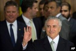 Brazil's acting President Michel Temer arrives to speak, at Planalto presidential palace in Brasilia, Brazil, Thursday, May 12, 2016.