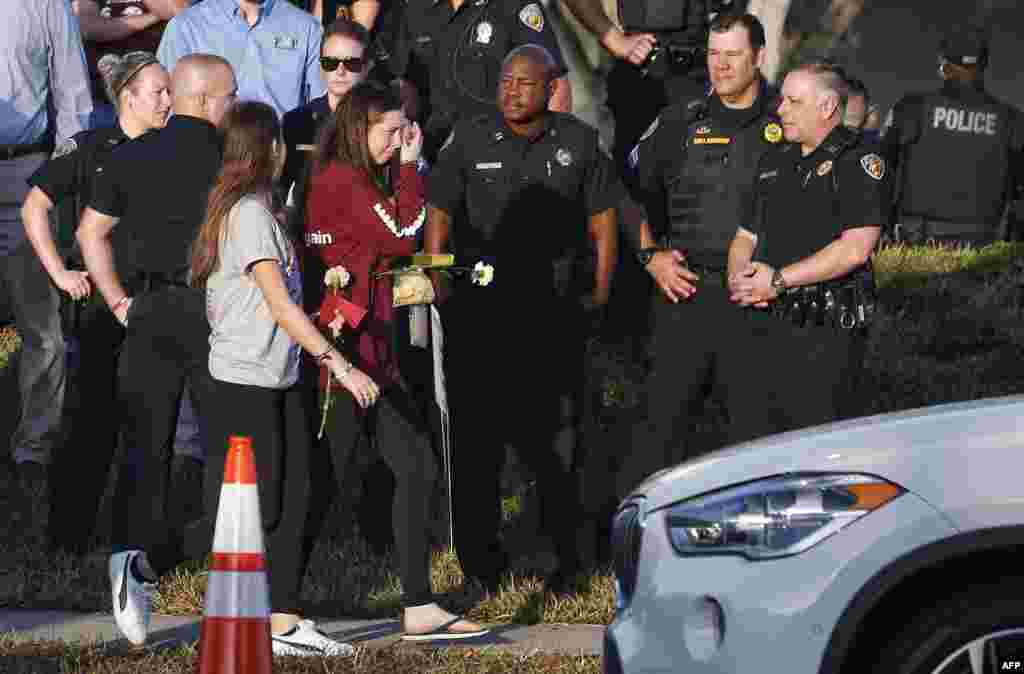Marjory Stoneman Douglas High School staff, teachers and students who return to school are greeted by police and well wishers in Parkland, Florida. The community of Parkland steeled itself for the resumption of classes at Marjory Stoneman Douglas High School, where nearby flower-draped memorials and 17 white crosses pay tribute to the 14 students and three staff members who were murdered by a former student.