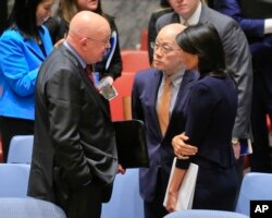 FILE - United Nations Ambassadors Vasily Nebenzya of Russia, left, Liu Jieyi of China, center, and Nikki Haley of the U.S., right, confer after the United Nations nonproliferation meeting on North Korea, Sept. 4, 2017 at U.N. headquarters.