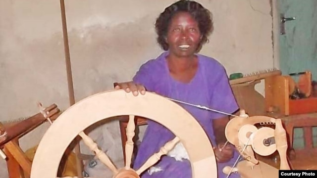 Co-founder Margaret Adhiambo works on Kapendeza's spinning wheel (VOA/Ajanga Khayesi)