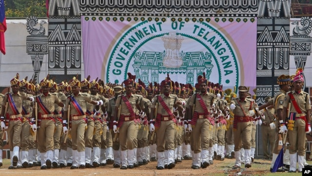 Indian police march during the Telangana formation day celebrations at parade grounds in Hyderabad, India,  June 2, 2014.