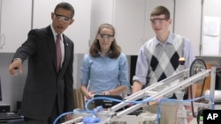 President Barack Obama and students at Thomas Jefferson High School in Virginia, Sept. 16, 2011.