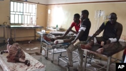 FILE- Victims of an explosion receive treatment at a ill-staffed health facility in Maiduguri, Nigeria, Sept. 21, 2015.