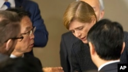 Motohide Yoshikawa, left, Japan's ambassador to the United Nations, talks with Samantha Power, the U.S. ambassador, following a Security Council meeting at U.N. headquarters, Sunday, Feb. 7. Some are pushing for the UN to name its first woman secretary-general. (AP Photo/Mark Lennihan)