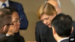 Motohide Yoshikawa, left, Japan's ambassador to the United Nations, talks with Samantha Power, the U.S. ambassador, following a Security Council meeting at U.N. headquarters, Sunday, Feb. 7, 2016.