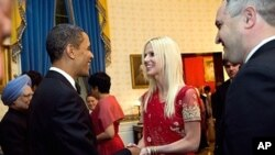 In this handout image provided by The White House, President Barack Obama greets Michaele Salahi and Tareq Salahi at a State Dinner in the State Dining Room of the White House November 24, 2009