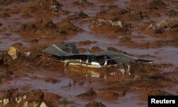 FILE - Debris of a house is shown at Bento Rodrigues district, which was covered with mud after a dam owned by Vale SA and BHP Billiton Ltd burst in Mariana, Brazil, Nov. 6, 2015.