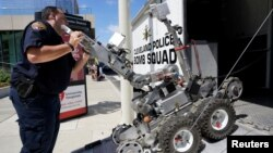 A Cleveland police bomb squad technician loads a Remotec F5A explosive ordnance device robot during a demonstration of police capabilities near the site of the Republican National Convention in Cleveland, Ohio, July 14, 2016.