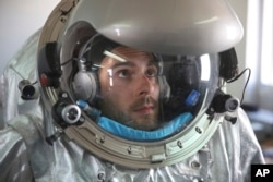 This Feb. 7, 2018, photo shows Joao Lousada, a flight controller for the International Space Station, wearing an experimental space suit during a simulation of a future Mars mission in the Dhofar desert of southern Oman.