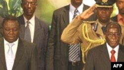 Prime Minister Morgan Tsvangirai (L) and President Robert Mugabe (R).