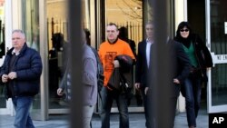 José Ignacio de Juana Chaos, centre, a convicted former ETA terrorist leaves a court in Belfast, Northern Ireland