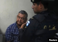FILE - Suspect Waldemar Lorenzana Lima (L) sits after his arrest in Guatemala City, April 26, 2011.