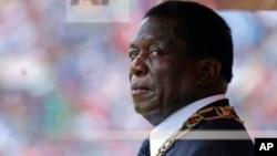 Zimbabwe's President Emmerson Mnangagwa prepares to inspect the guard of honour during the celebrations for the country's 38th anniversary of Independence at the National Sports Staduim in Harare, Wednesday, April, 18, 2018. Thousands of people gathered f