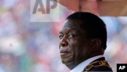 FILE: Zimbabwe's President Emmerson Mnangagwa prepares to inspect the guard of honour during the celebrations for the country's 38th anniversary of Independence at the National Sports Staduim in Harare, Wednesday, April, 18, 2018. Thousands of people gathered f