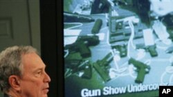 New York City Mayor Michael Bloomberg shows an undercover video that he says shows undercover investigators working for New York City were not required to pass a background check at a Phoenix, Arizona, gun show, January 31, 2011