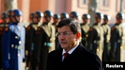 Turkey's Prime Minister Ahmet Davutoglu arrives at welcoming ceremony, Ankara, Dec. 25, 2014.