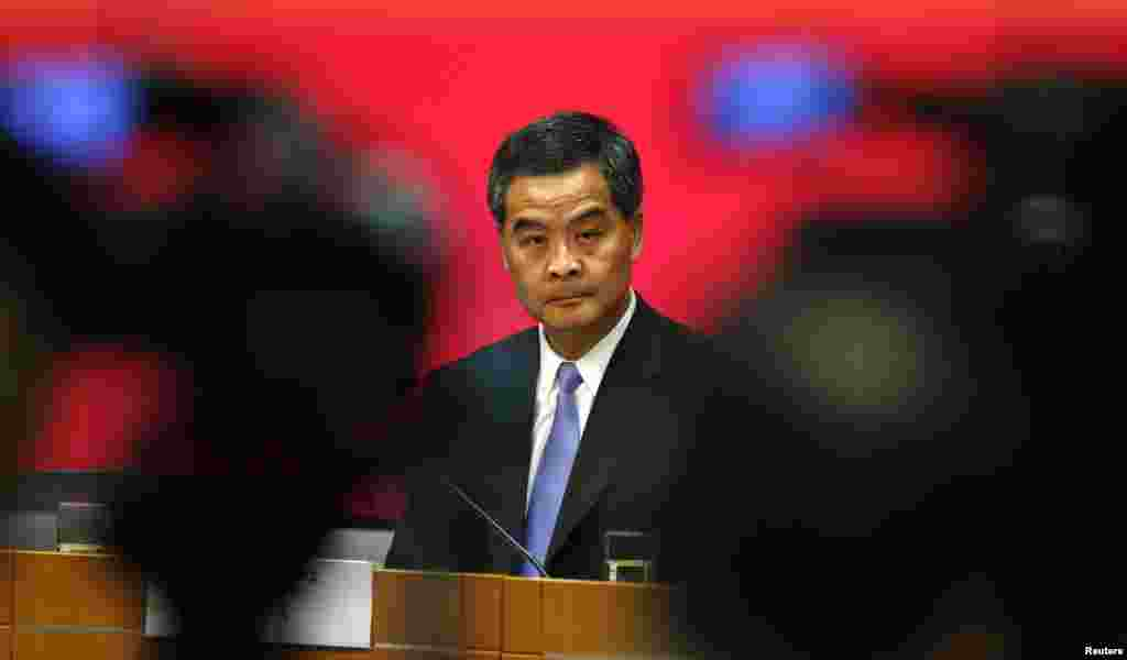 FIILE - Hong Kong Chief Executive Leung Chun-ying looks on in between video cameras during a news conference in Hong Kong July 15, 2014.