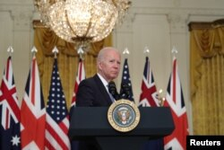 U.S. President Joe Biden delivers remarks on a National Security Initiative virtually with Australian Prime Minister Scott Morrison and British Prime Minister Boris Johnson, both not pictured, inside the East Room at the White House, Sept. 15. 2021.