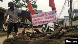 Dựng chướng ngại vật trong vụ tranh chấp đất tại Đồng Tâm. Hình minh họa.