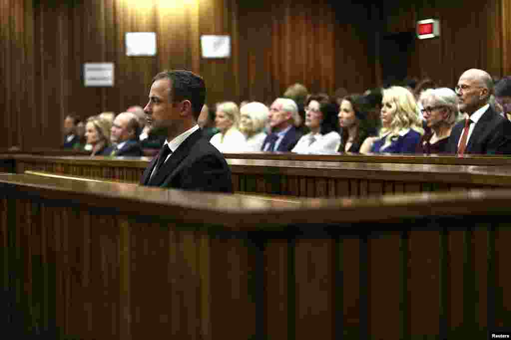Oscar Pistorius listens to Judge Thokozile Masipa deliver her verdict, Sept. 12, 2014.