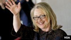 Hillary Rodham Clinton waves as she leaves the State Department, Feb. 1, 2013