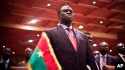 Burkina Faso's transitional president Michel Kafando attends the official handover ceremony returning him to office in Ouagadougou, Burkina Faso, Sept. 23, 2015.