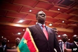 Burkina Faso's transitional president Michel Kafando attends the official handover ceremony returning him to office in Ouagadougou, Burkina Faso, Wednesday, Sept. 23, 2015.