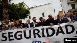 """People hold a banner thats reads """"Security"""" during a protest against drug trade and insecurity in the Campo de Gibraltar area, in Algeciras, southern Spain, May 17, 2018."""
