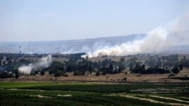 Smoke rises from the Israeli occupied Golan Heights near the Kuneitra border crossing, close to the ceasefire line between Israel and Syria, June 6, 2013.