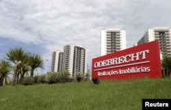FILE - A sign of the Odebrecht SA construction conglomerate is pictured in Rio de Janeiro, Brazil, Feb. 26, 2016.