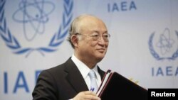 Tổng giám đốc Cơ quan Nguyên tử năng Quốc tế IAEA Yukia Amanos đến dự một cuộc họp tại Vienna.