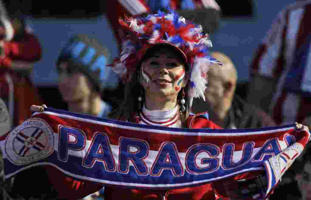 A Paraguayan fan poses for pictures before the Copa America final soccer match between Uruguay and Paraguay in Buenos Aires, Argentina, Sunday, July 24, 2011. Uruguay is trying to become the tournament's most successful team, while Paraguay is looking to