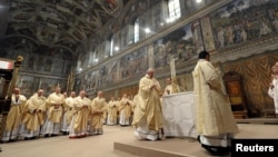FILE - Pope Francis leads a a mass with cardinals at the Sistine Chapel at the Vatican.