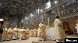 FILE - Pope Francis lead a mass with cardinals at the Sistine Chapel, in a picture released by Osservatore Romano at the Vatican, March 14, 2013.