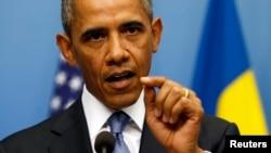 4일 스웨덴을 방문한 바락 오바마 미국 대통령이 기자회견에서 시리아 사태에 대한 입장을 밝히고 있다.