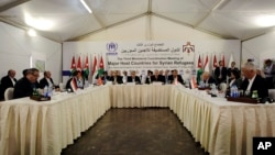 UN High Commissioner for Refugees (UNHCR) Antonio Guterres (C-L) speaks during the third Ministerial Coordination Meeting of Major Host Countries for Syrian Refugees, at Zaatari Refugee Camp in Mafraq, Jordan, May 4, 2014.