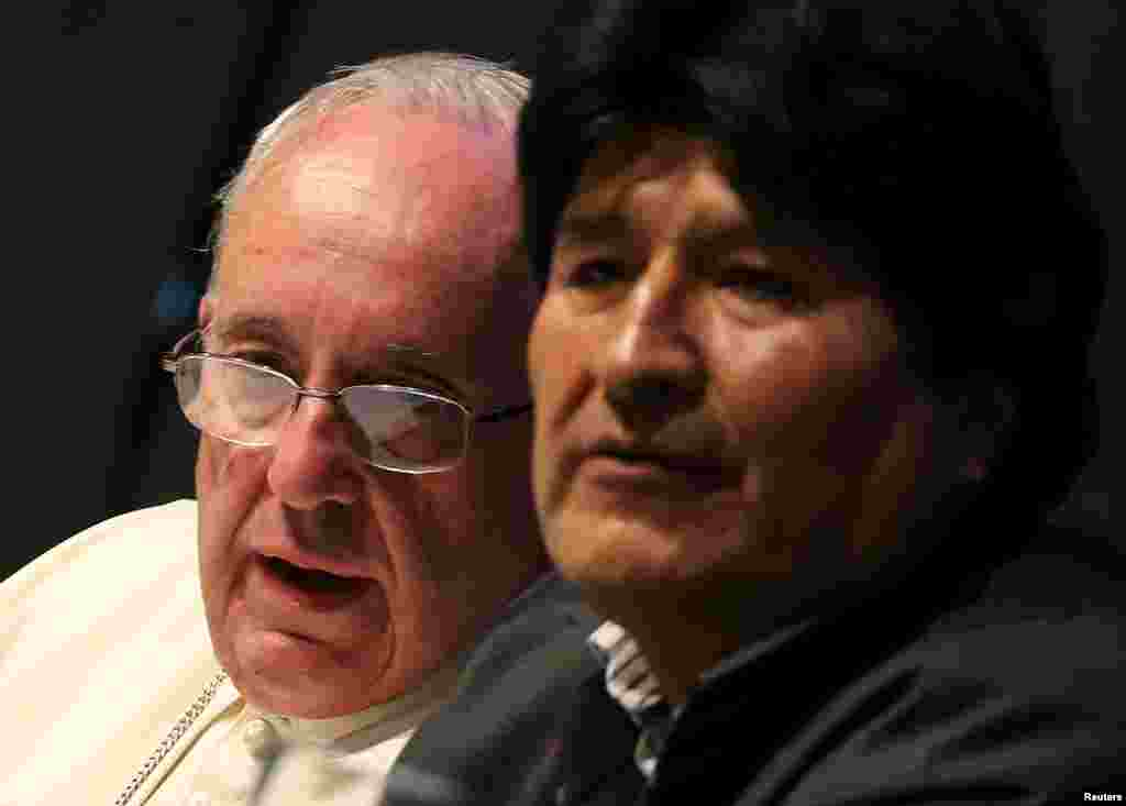 Pope Francis speaks to Bolivian President Evo Morales (right) during a World Meeting of Popular Movements in Santa Cruz, July 9, 2015.