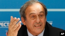 FILE - UEFA President Michel Platini (now suspended) delivers his speech during a press conference after the soccer Europa League draw ceremony at the Grimaldi Forum, in Monaco, Aug. 28, 2015.