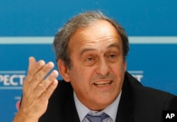 FILE - UEFA President Michel Platini delivers his speech during a press conference after the soccer Europa League draw ceremony at the Grimaldi Forum, in Monaco, Aug. 28, 2015.
