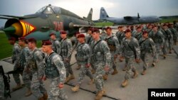 First company-sized contingent of about 150 U.S. paratroopers from the U.S. Army's 173rd Infantry Brigade Combat Team based in Italy march as they arrive to participate in training exercises with the Polish army in Swidwin, Poland, April 23, 2014.