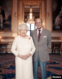 Britain's Queen Elizabeth II and Prince Philip, Duke of Edinburgh, at Windsor Castle in early November. They celebrate their platinum wedding anniversary, Nov. 20, 2017. (Matt Holyoak/CameraPress/PA Wire/Handout via REUTERS)
